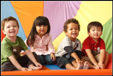 Toddlers sitting on a sheet