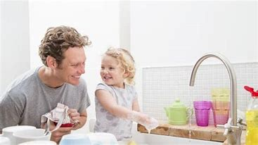 Dad and Toddler wash dishes